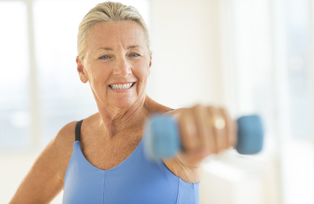 Senior woman - at home exercises