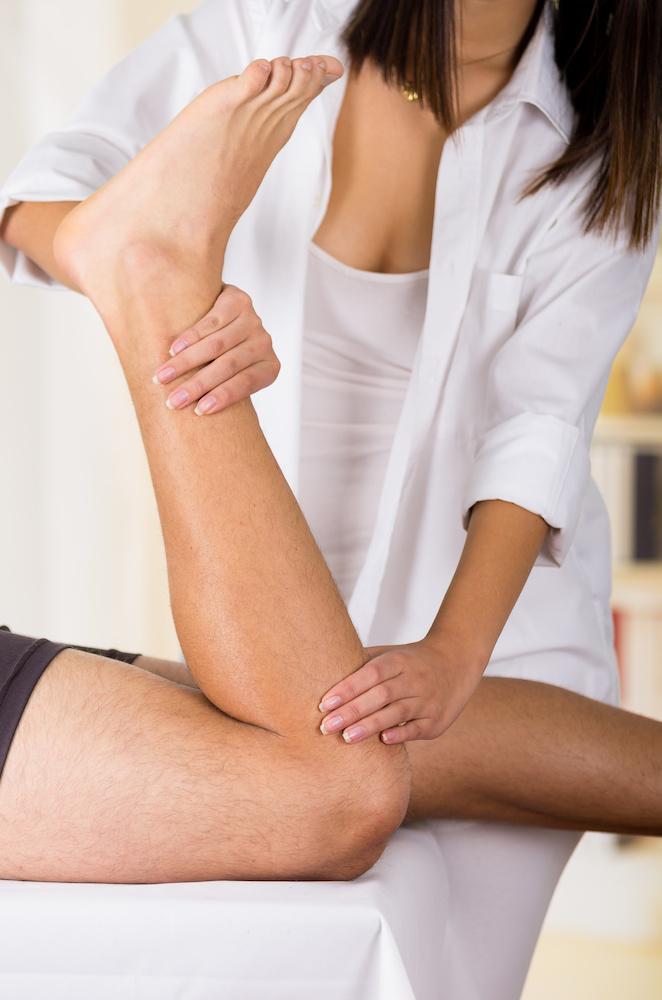 Physiotherapist assessing injury